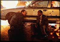 Lethal Weapon 4 - Safety behind police car from a shower of bullets and flamer thrower